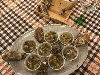 Oysters in orange sauce