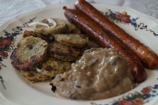 Knödel and lamb sausages with mushroom sauce