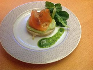 Avocado mousse with salmon and grape fruit